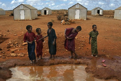 Families in front of 'Better Shelters' at the Hilawyen refugee camp in Dollo Ado, Ethiopia.