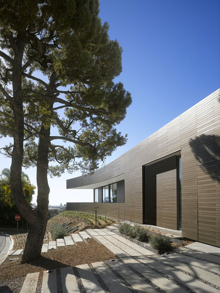 The facade is sheathed in anodized aluminum panels. Image courtesy of SPF:architects