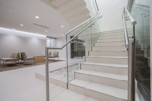 The bottom of the staircase provides the needed 12″ extension for commercial handrail applications