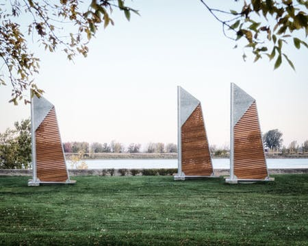 The 'Sails Benches' line the Vercheres park located near the St. Lawrence River.