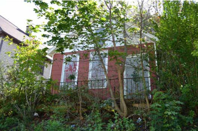 a small single-family house on Buffalo's East side via Matthieu Bain and Andrew Perkins