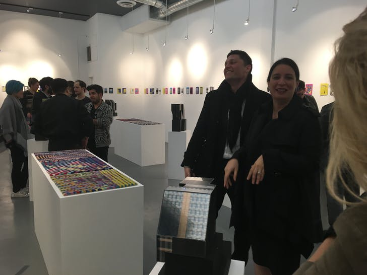 Andrei Zerebecky (third from right) and Elena Manferdini (second from right) get into the groove of the 'Building Portraits' opening at ToCo Haus Gallery.