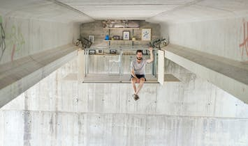 A self-taught designer builds a secret work studio on the underside of a bridge