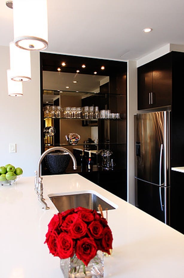 Wet bars use stainless steel to contrast the Wenge wood veneer cabinets.