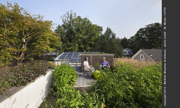 The uppermost terrace includes shade trees, vegetable garden and hang-out space overlooking the solar array.