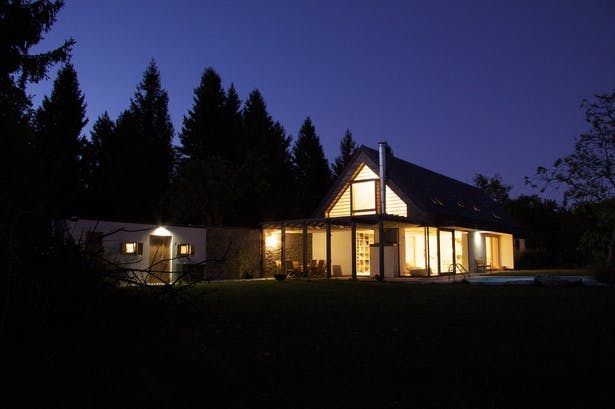 House A, exterior, night view