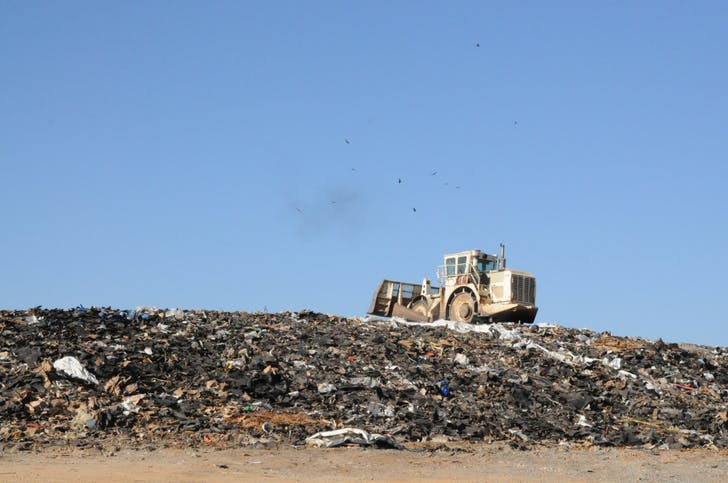 Construction waste fills a landfill. Via: http://tlfearthexchange.wordpress.com/