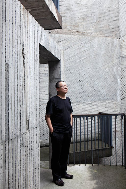 Architect Wang Shu at the Xiangshan campus of the China Academy of Art. The walls bear the imprint of the bamboo forms into which the concrete was poured. Photography by Zeng Han