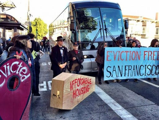 Protestors in front of a tech shuttle bus in San Francisco, 2013. Image via SFGate.