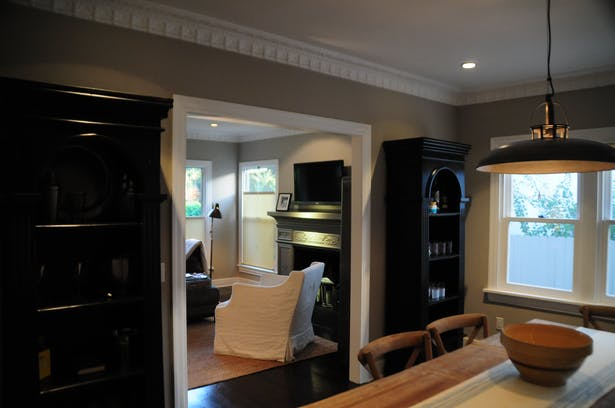 Restoring the fireplace surround, moulding and original hardwood floors kept that 'bungalow' feel.