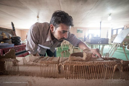 Using clay and wooden kebab skewers, Syrian refugee Mahmoud Hariri built a model of the ancient city of Palmyra. (Photo: UNHCR/Christopher Herwig)