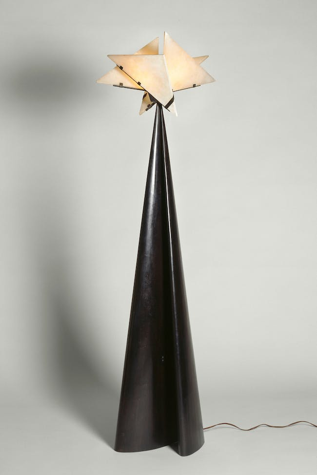 La Religieuse floor lamp (SN31), 1923, designed by Pierre Chareau, alabaster and hammered brass, 67 3⁄8 × 17 ¾ × 21 5⁄8 in. (171 × 45 × 55 cm). Centre Pompidou, Musée National d'Art Moderne, Centre de Creation Industrielle. Paris. Purchase funded in part by Scaler Foundation in 1995. Photo courtesy of The Jewish Museum.