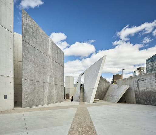 This interior view of the central space shows the application of Edward Burtynsky's large-scale, monochromatic photographic impressions of Holocaust sites, painted in great detail on the towering concrete walls.