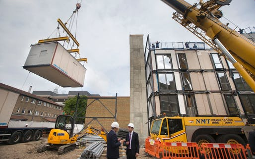 Construction workers installing modular flats for an estate regeneration project in Lambeth (Credit: Heathcliff O'Malley)