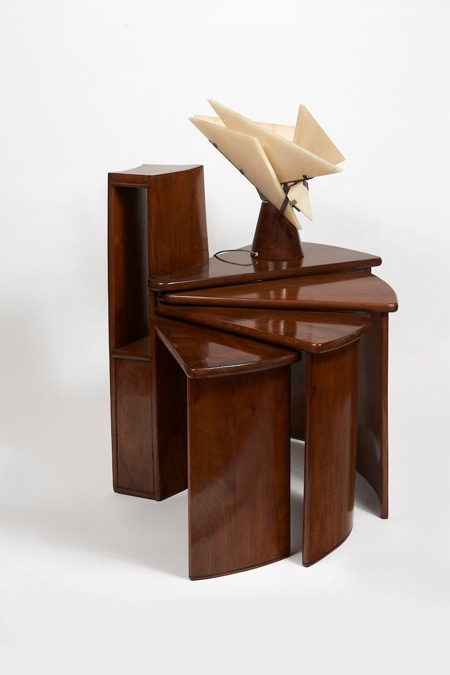 Telephone table (MB152) and Religieuse table lamp, c. 1924, designed by Pierre Chareau (French, 1883-1950). Table: walnut and patinated wrought iron; 31 3⁄4 × 401⁄8 (extended) × 15 in. (80.5 × 102 × 38 cm). Lamp: walnut, patinated wrought iron, and alabaster; 161⁄8 in. (41 cm) high. Collection Dominique Suisse