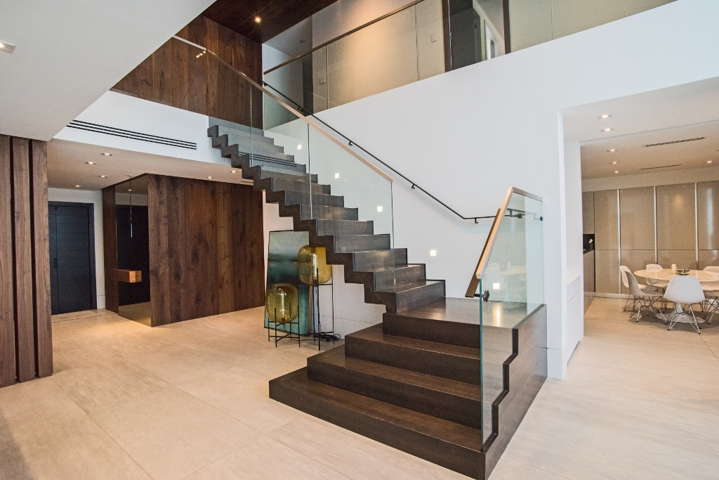 Awesome Stainless Steel Cap Rails U0026 Handrails Were Added To This Grande Contemporary  Staircase, Tying In