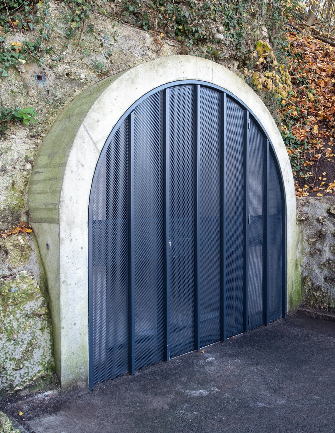Gate 2 When closed the gates form translucent walls that close off the tunnel from & Tunnel of Memory | Bernhard Denkinger Architect | Archinect