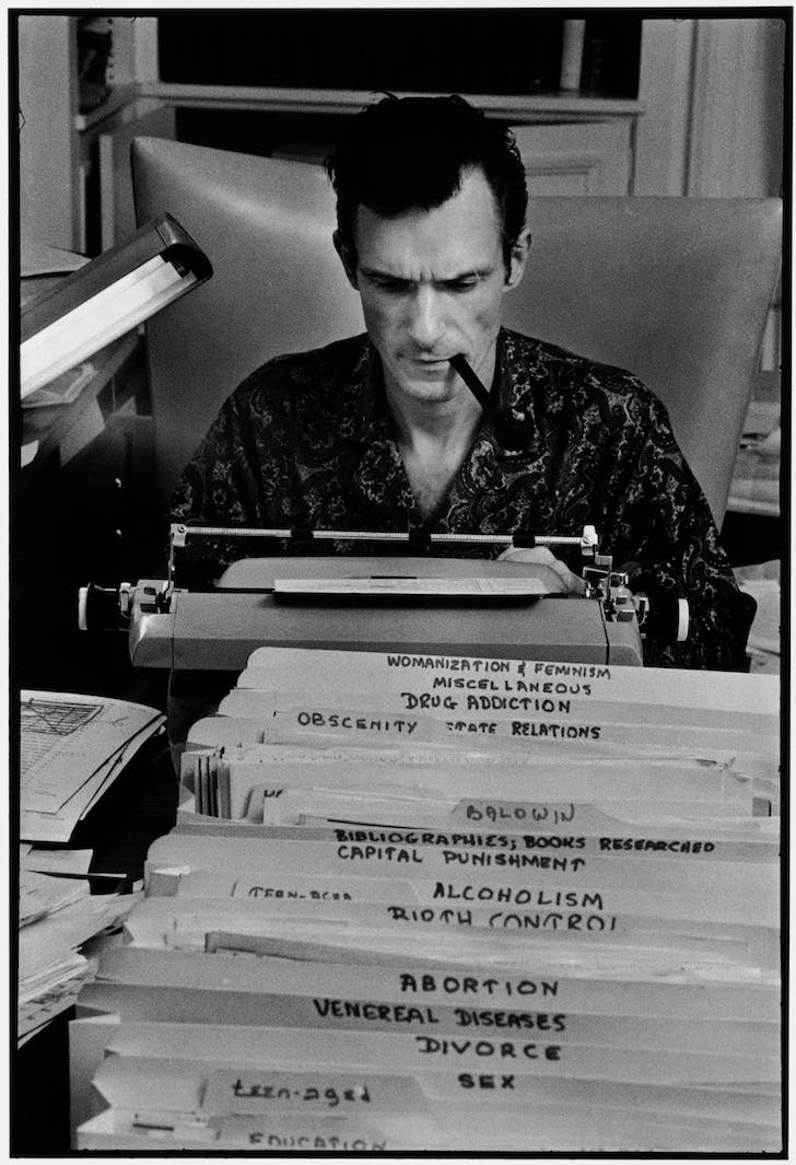 Hugh Hefner at work. Image courtesy Elmhurst Art Museum.
