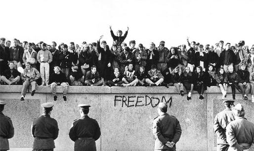 East German guards watch the crowds massing on top of the Berlin Wall in 1989. Photo: GDR Museum