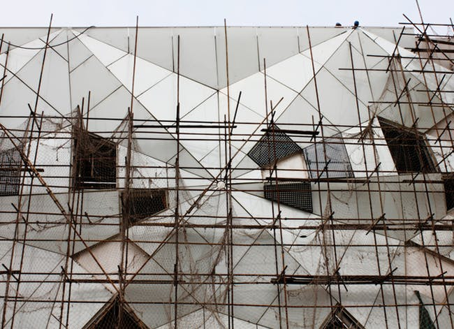 Scaffolding on the geometric façade of the Datong Library. Credit: Preston Scott Cohen, Inc.