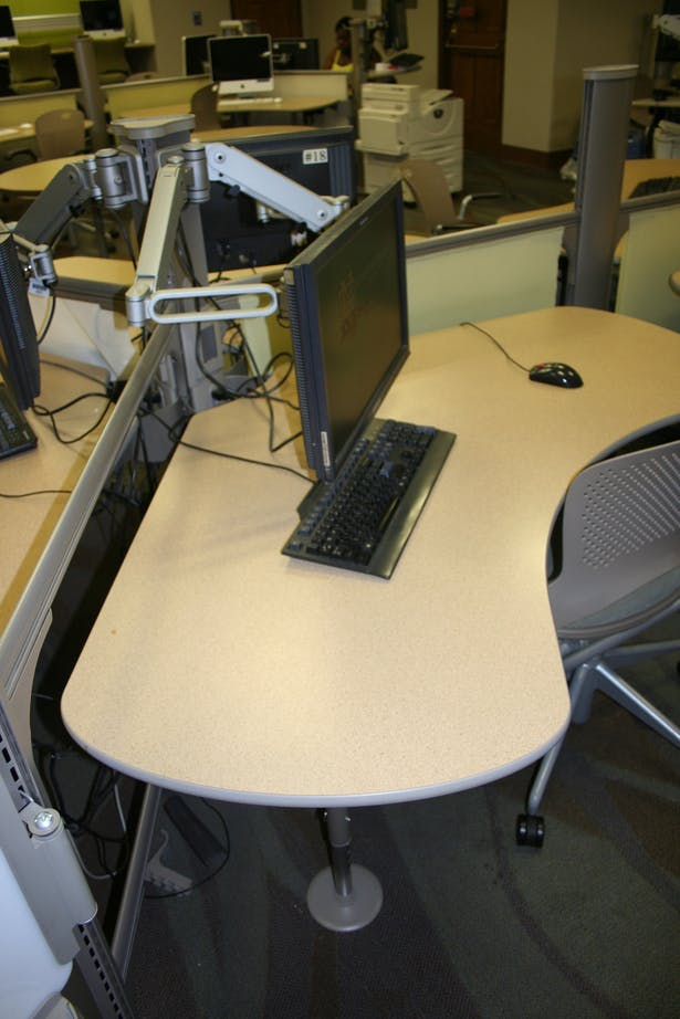 A close-up of a desk for student use.