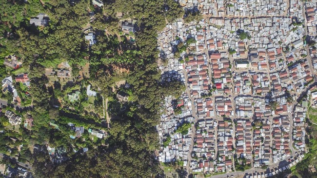 Hout Bay / Imizamo Yethu, Cape Town, South Africa, from the drone photo series 'Unequal Scenes' by Johnny Miller.