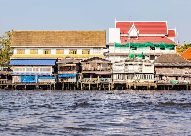 Chao Phraya River, in Bangkok, Thailand. Houses elevated on stilts lie on the Chao Phraya riverside. Photo: Dario Lo Presti