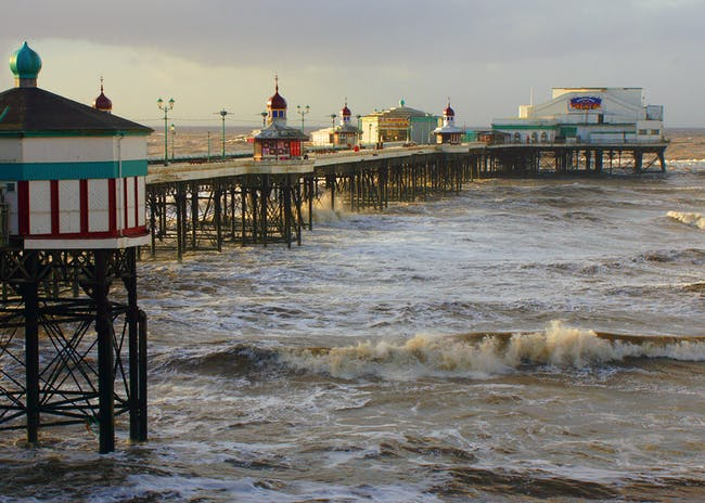 Blackpool Piers, in Blackpool, United Kingdom. View of the the North Pier, the oldest of three in Blackpool, originally a promenade lined with octagonal wooden kiosks. Photo: Gidzy