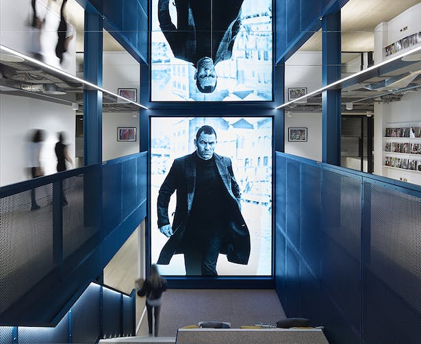An LED illuminated panel changes to showcase different magazine covers and photographs
