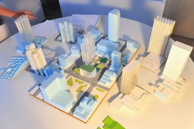 These are some of the site models that Studio Gang was bringing to Lexington for a public meeting on Thursday, June 2, 2011, to show design alternatives for the CentrePointe block. The CentrePointe block is in the middle of the rectangle; the block can be removed and replaced with one of the other blocks on the table.