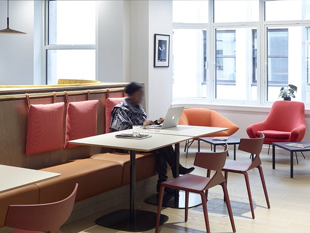 Informal work areas are lit-filled, with flecks of yellows, oranges and reds