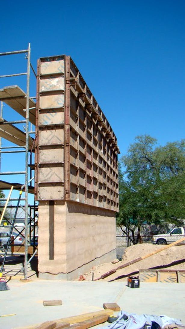 removing layers of formwork from rammed earth