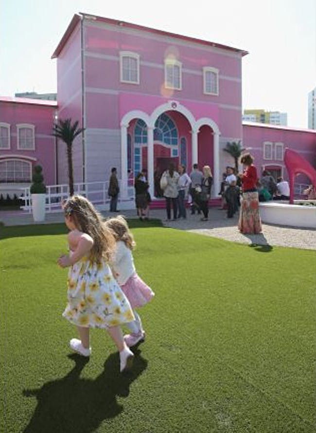 Visitors wait to enter the Barbie Dreamhouse Experience on May 16, 2013 in Berlin, Germany. [Sean Gallup/Getty Images]