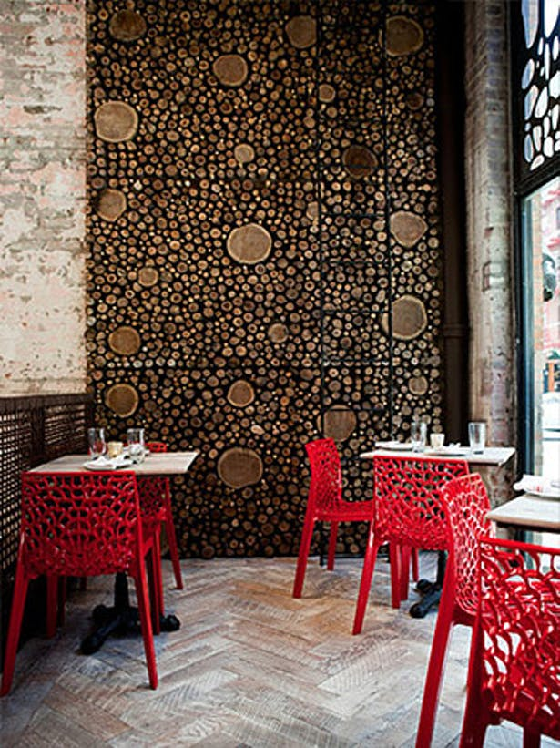 Whimsical chairs and window panels are reminiscent of urban Barcelona
