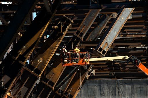 Workers install braces to connect the tower's pedestal to the core. Credit Bryan Thomas for The New York Times
