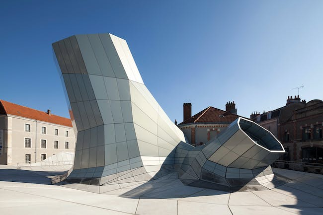 FRAC Centre - Permanent and Temporary Exhibition rooms in Orléans, France by Jakob+Macfarlane. Photo © Roland Halbe