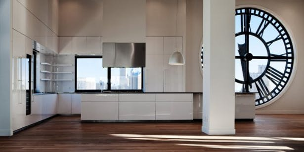GLAM Kitchen: white lacquer with 45-degree edged and black melamine interiors and stainless steel drawers.