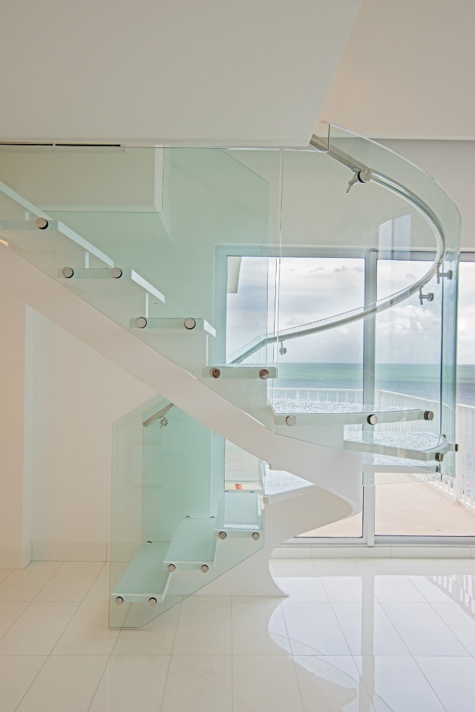 Curved Glass Railings Were Added To Allow Natural Light In Without  Obstructing Those Beautiful Ocean Views