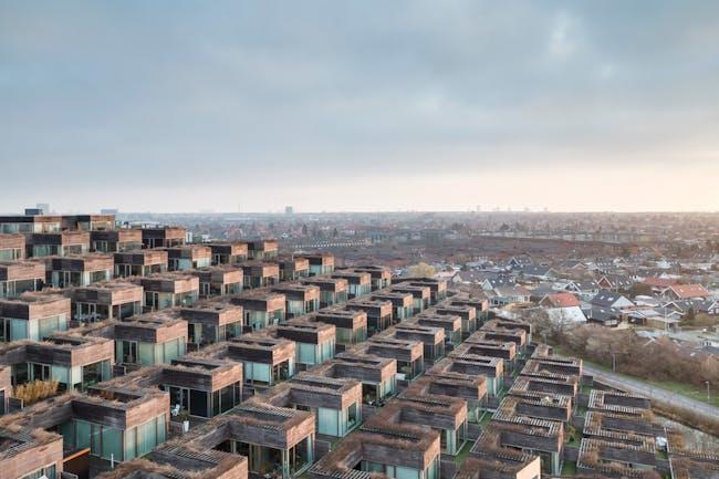 Sense of Place: Bjerget (Mountain Dwellings) by Bjarke Ingels and JDS Architects. Photo by Pawel Paniczko.