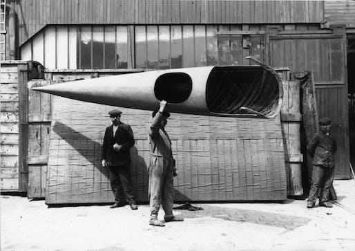Workman carrying a complete Deperdussin monocoque fuselage, Deperdussin factory, Paris, about 1912. Photo © Musée de l'air et de l'espace.