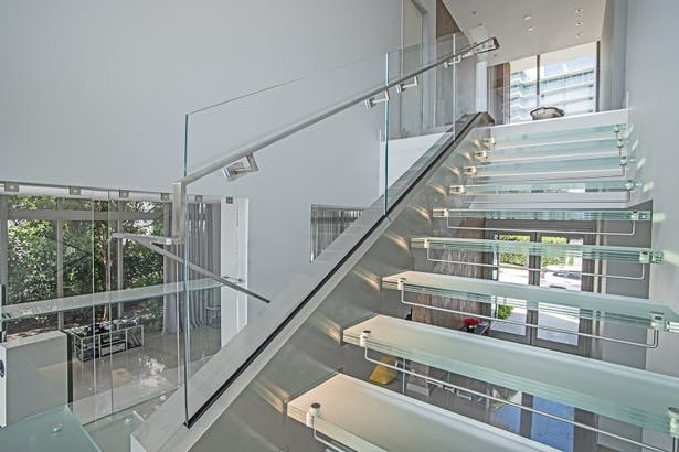 A Brushed Stainless Steel Handrail Was Installed Directly Onto The Starphire Gl Railings