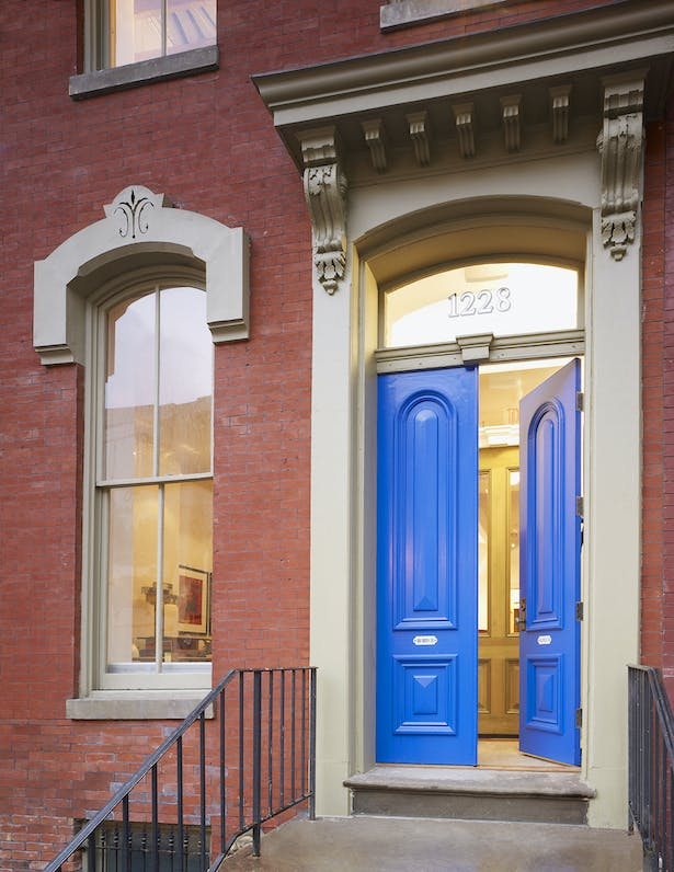 Blue doors of BELL Architects main entry