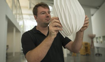 Joseph Choma demonstrates his nifty paperfolding technique for fiberglass