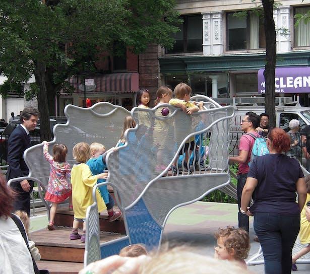kids on the dinosaur slide