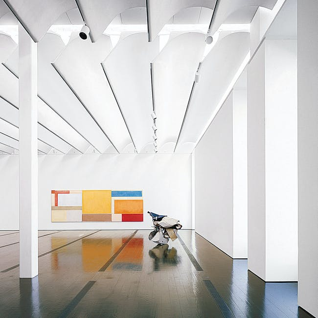 """View of one of the galleries. The """"leaves"""" of the roof filter the light and drastically reduce the interior light levels (Photo: Hester Paul)"""