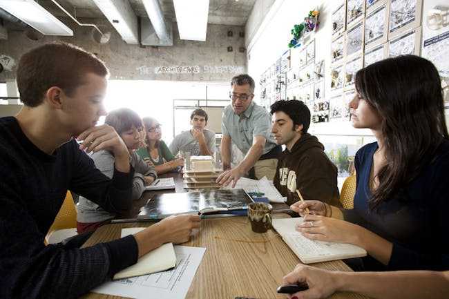 The University of Oregon's Associate Dean Brook Muller works with UO architecture students on a studio design project that aligns urban redevelopment and improved ecological function