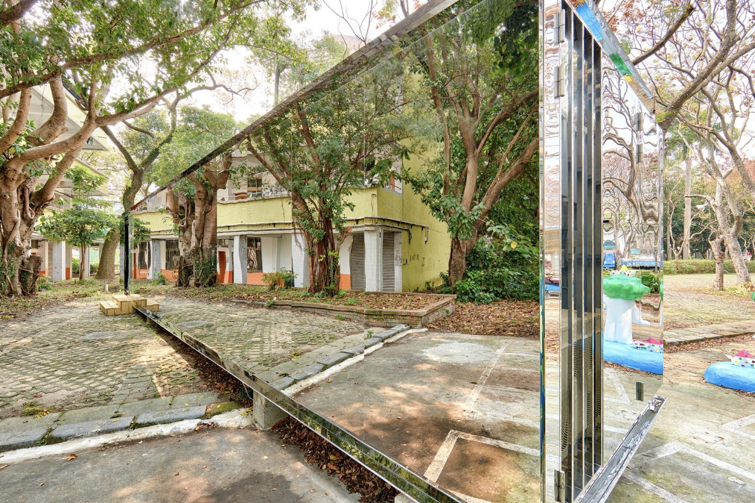 B+P Architects, based in Taiwan, design mirrored art-annex