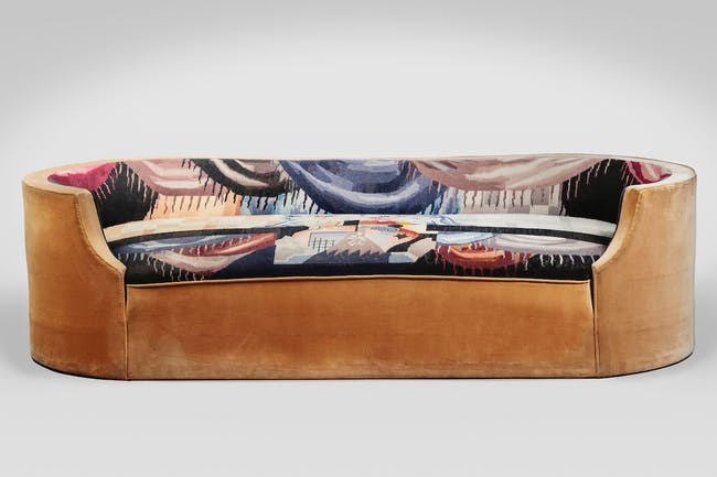 Corbeille sofa (MP169), 1923, designed by Pierre Chareau (French, 1883-1950) with upholstery designed by Jean Lurçat (French, 1892-1966), velours and tapestry, 231⁄2 × 771⁄4 × 171⁄4 in. (59.7 × 196.1 × 43.9 cm). Audrey Friedman and Haim Manishevitz, Primavera Gallery