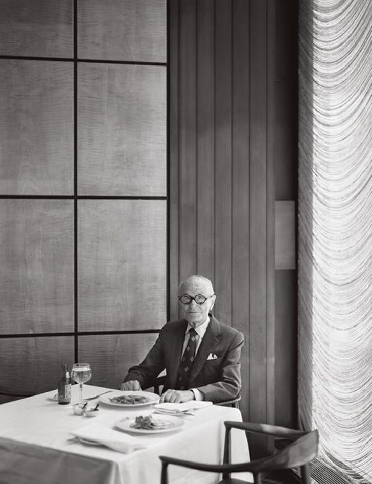 Philip Johnson at a corner table in the Grill Room, Seagram Building, New York. Courtesy of Dirty Furniture.
