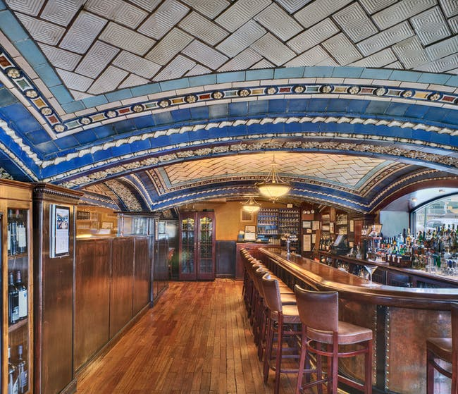 The Della Robbia Room of the Vanderbilt Hotel in New York is considered one of the most outstanding examples of decorative Guastavino vaulting ever built. Working with architects Warren and Wetmore, Guastavino Jr. developed a series of shallow vaults on arches, which were layered with ceramic pieces that created a relief of color. Photo © Michael Freeman. Courtesy of the Museum of the City of New York